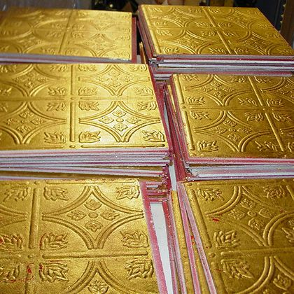 Gold gilded Armstrong ceiling tile