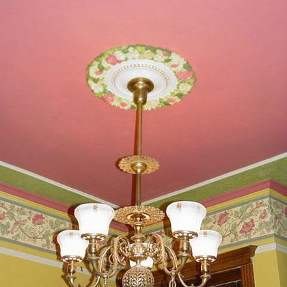 Compound cornice with painted wall borders