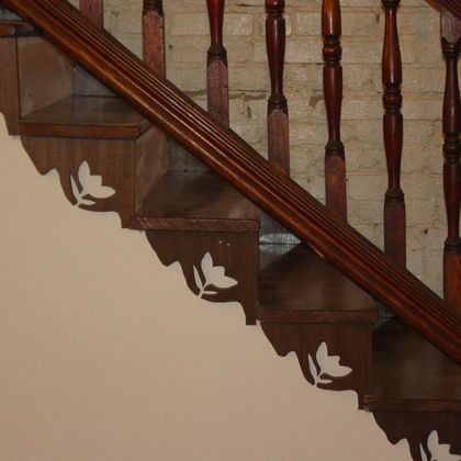 Scroll saw carved stair brackets
