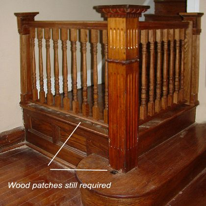 stair landing renovation with newel and gate