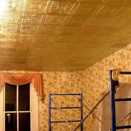 Gilded Armstrong ceiling tile being installed