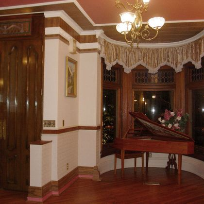 Tall entrance doors with Victorian Wallpaper